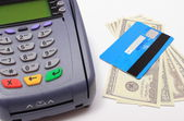 Payment terminal with credit card and money on white background — Stock Photo