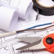Accessories for engineer jobs and rolls of diagrams on construction drawing — Stock Photo #63980501