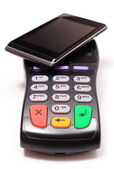 Payment terminal and mobile phone with NFC technology — Stock Photo