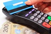 Hand of woman paying with contactless credit card, NFC technology — Stock Photo