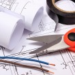Accessories for engineer jobs and rolls of diagrams on construction drawing — Stock Photo #65507669