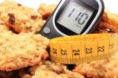 Glucometer, oatmeal cookies and tape measure — Foto de Stock