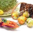 Easter palm and eggs in overturned wicker basket and watercress — Stock Photo #66293549