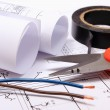 Accessories for engineer jobs and rolls of diagrams on construction drawing — Stock Photo #66789345