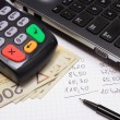 Payment terminal, money, laptop and financial calculations — Stock Photo #68056939