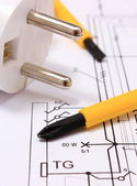 Screwdriver and electric plug on construction drawing — Stock Photo