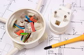 Screwdriver, electrical box and electric plug on construction drawing — 图库照片