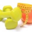 Dumbbells for using in fitness, fresh fruit and tape measure — Stock Photo #70659835
