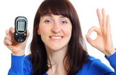 Smiling woman with glucose meter on white background — Stock Photo