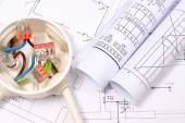 Electrical box with cables and diagrams on construction drawing — Stock Photo