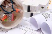 Electrical box, diagrams and electric fuse on construction drawing — Stock Photo