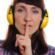 Woman wearing protective headphones, silence sign — Stock Photo #74216879