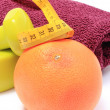 Dumbbells and towel for using in fitness, fresh fruit with tape measure — Stock Photo #75115163