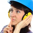 Woman wearing protective helmet and headphones, silence sign — Stock Photo #75116119