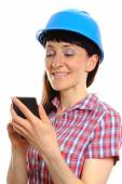 Builder woman in protective helmet using mobile phone — Stock Photo
