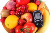 Glucometer with fruits and vegetables on wooden plate — Stock Photo