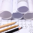 Rolls of electrical diagrams and pencils — Stock Photo #77691128