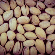 Vintage photo, Pistachio nuts as background, healthy eating — Stock Photo #79204314