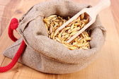 Organic oat grains in jute bag, healthy nutrition — Stock Photo