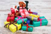 Teddy bear with colorful gifts for Christmas or other celebration — Stock Photo