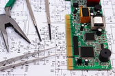 Printed circuit board and precision tools on diagram of electronics, technology — Stock Photo