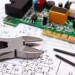 Printed circuit board and precision tools on diagram of electronics, technology — Stock Photo #82545016