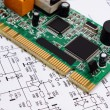 Printed circuit board lying on diagram of electronics, technology — ストック写真 #83298676