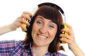 Builder woman wearing protective headphones — Stock Photo