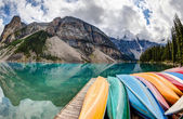 Row of Kayaks on Moraine Lake in the Canadian Rockies — Stock Photo