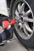 Using Impact Wrench to Change Tires — Photo