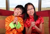 Two Kids Offering Chinese New Year Greetings — Stock Photo