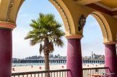 Palm on beach through terrace window — Stock Photo