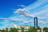 Ekaterinburg skyscraper on background of old buildings — Stock Photo