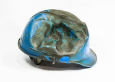 Safety helmet on white background. damage by heat and fire — Stock fotografie