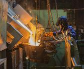 Operator recieve molten metal — Stock Photo