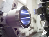 Industrial metal work machining process by cutting tool on CNC l — Stock Photo