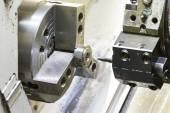 Turning automotive part by cnc lathe — Stock Photo