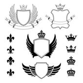 Set of winged shields - coat of arms - heraldic design elements, fleur de lis signs and royal crown silhouettes — Stock Vector