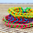Colorful Rainbow loom bracelet rubber bands fashion close up — Stock Photo #52582871