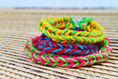 Colorful Rainbow loom bracelet rubber bands fashion close up  — Stock Photo