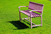 The pink steel bench  On green grass — Stock Photo