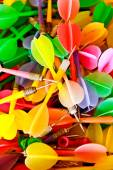 Close up of colorful plastic darts — Stock Photo