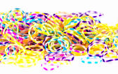 Close up of colorful elastic loom bands rainbow color full on wh — Stock Photo