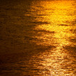 Golden shimmering Sea Water with wave,Sun light refection on sea — Stock Photo #54217961