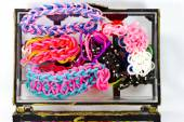 Close up of elastic loom bands color full in side box isolate on — Stock Photo