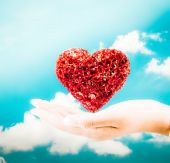 Heart onhand.Heart on the palm with sky background  - love symbo — Stock Photo