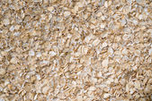 Delicious food background of beige cereals — Stock Photo