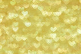 Defocused abstract golden hearts light background — Photo