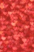 离焦模糊抽象红心明亮的背景 — 图库照片