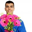 Man holds pink Gerbera flowers — Stock Photo #64471765